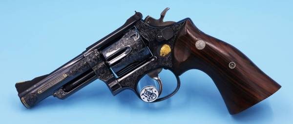 """Smith & Wesson - SOLD Smith & Wesson Full coverage Engraved Model 19-2 4"""" Unfired Blue with a lot of Gold"""