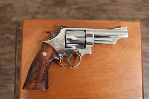 """Smith & Wesson - Smith & Wesson  Model 25-5 45 Long Colt 4"""" Nickel Extremely nice in Display case"""